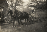 Men in horse-drawn buggy